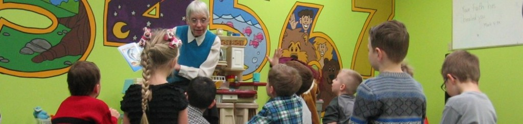Margaret Welwood reading to children