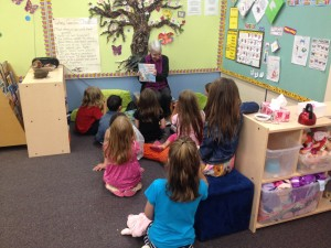 Grandma Margaret Welwood reading to children